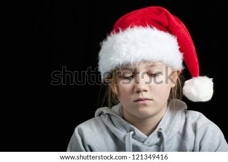 Sad girl at christmas time - stock photo