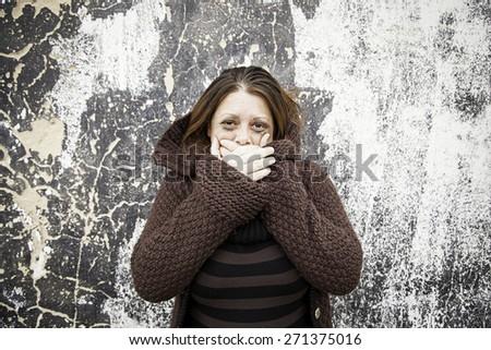 Sad girl crying in urban street feeling - stock photo