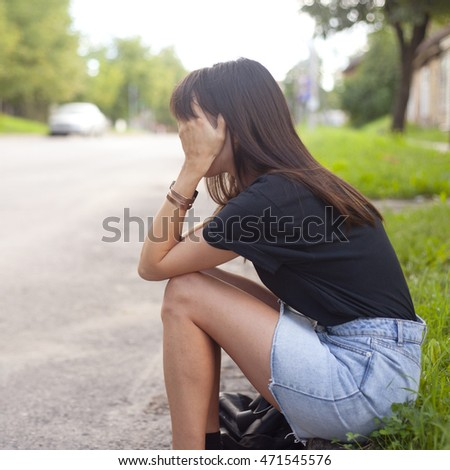 sad girl in the street