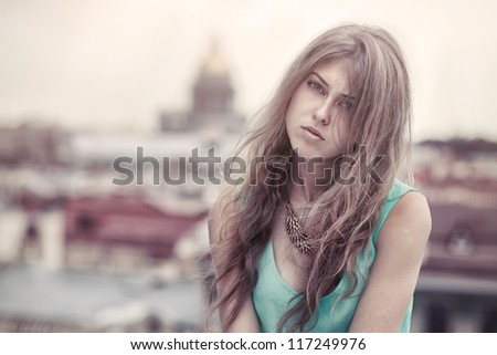Sad girl on a roof - stock photo