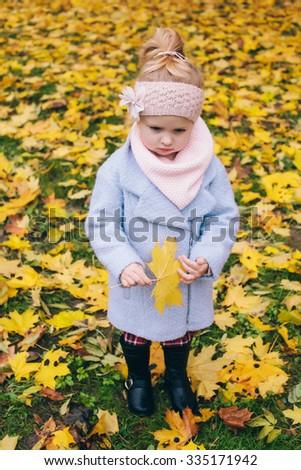 sad girl outdoors - stock photo