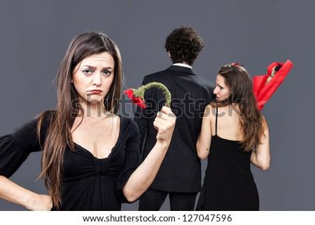sad girl remains alone with her withered flower - stock photo