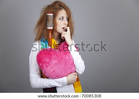 Sad girl with heart and comb. St. Valentine Day - stock photo