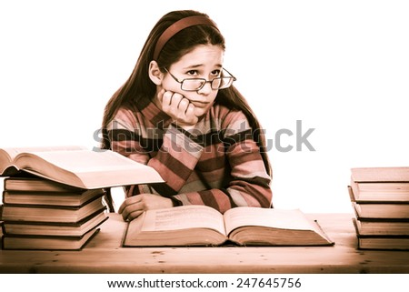 sad girl with pile of old books, sepia toned, isolated on white - stock photo