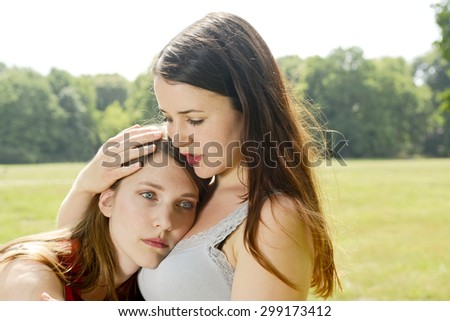 Sad girlfriend, consoling - stock photo