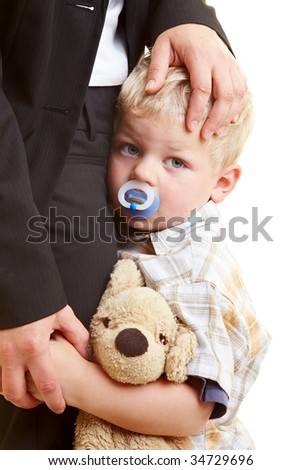 Sad infant hugging his mother - stock photo