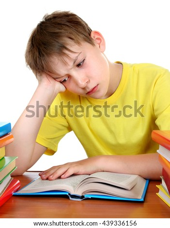 Sad Kid at the School Desk with a Books Isolated on the White Background