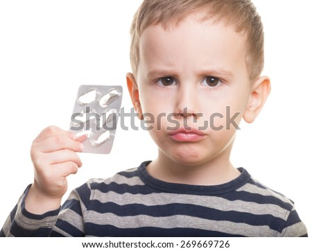 Sad kid with empty blister on isolated white - stock photo