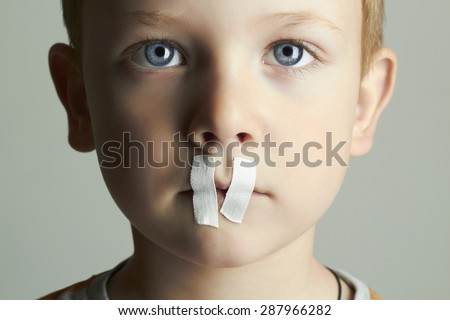 Sad Kid with sealed Mouth.handsome little boy - stock photo