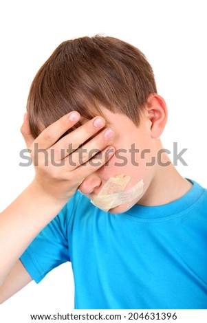 Sad Kid with sealed Mouth Isolated on the White Background - stock photo