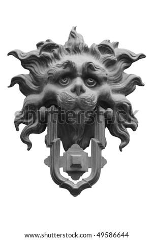 Sad lion antique door knocker - stock photo