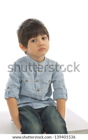 Sad Little Boy in Striped Shirt and Jeans - stock photo