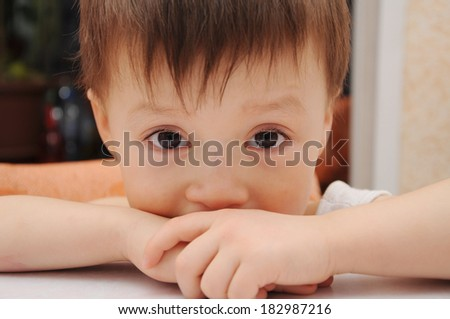 Sad little boy looking at you  - stock photo