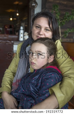 Sad little girl and her mother - stock photo
