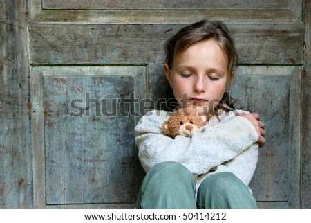 Sad little girl feels lonely. - stock photo