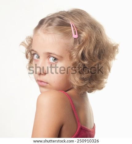 sad little girl portrait - stock photo