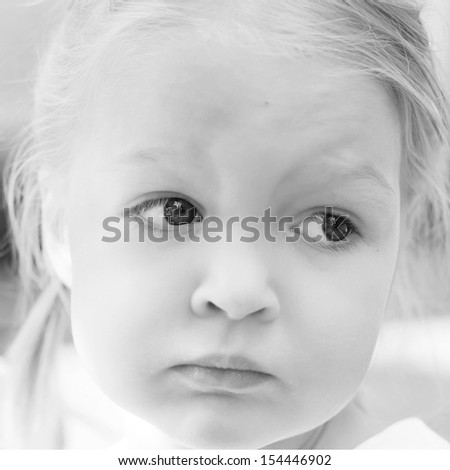Sad Little Girl. Portrait of a beautiful pensive little girl Black and White Photography - stock photo