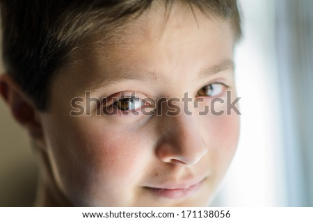 Sad looking boy - stock photo