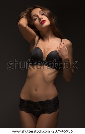sad luxury girl in black lingerie on dark image
