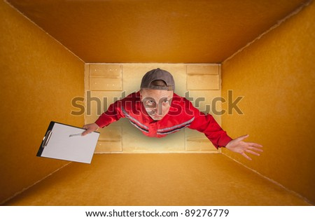 Sad mail courier with clipboard inside empty box - stock photo