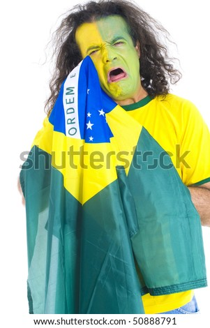 Sad Male Adult Brazilian Supporter holding a flag . - stock photo