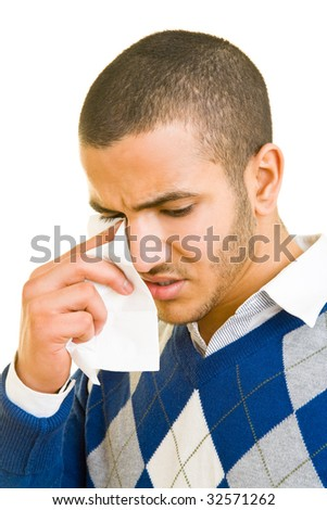 Sad man drying his tears with a paper tissue - stock photo