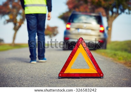 Sad man having car trouble on the country road. - stock photo