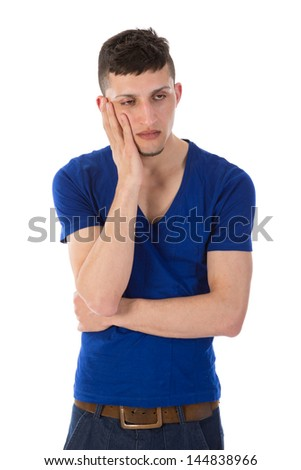 Sad man is thinking with hand against his head
