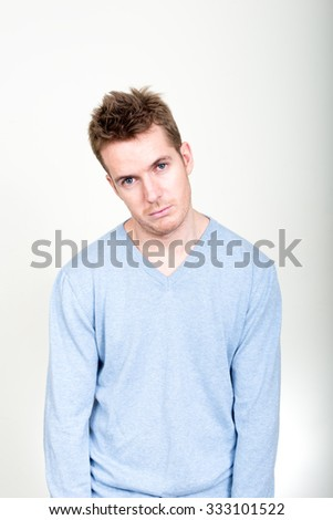 Sad man looking bored - stock photo