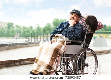 Sad man on a wheelchair - stock photo