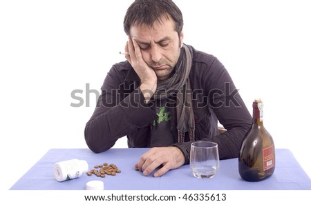 Sad man sitting at the table isolated over white background - stock photo
