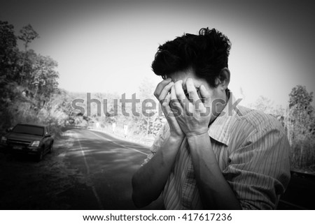 Sad man standing covers his face on road,Despair concept,Black and white - stock photo