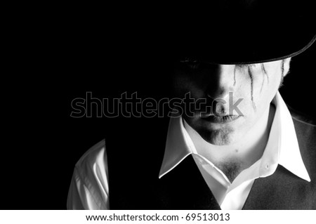 Sad man with hat - stock photo