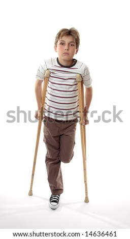 Sad melancholy boy with sore ankle using crutches - stock photo