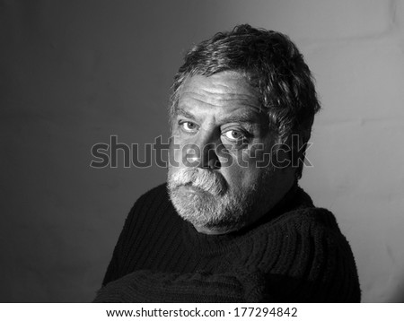 sad middle-aged bearded man - stock photo