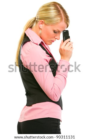 Sad modern business woman holding mobile near forehead - stock photo