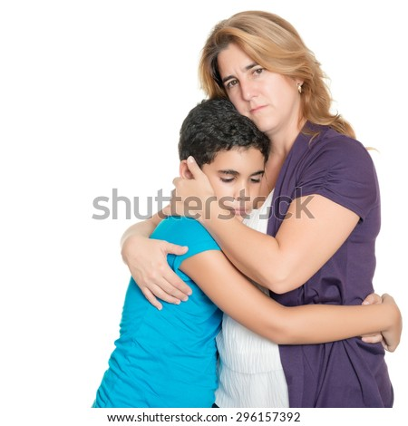 Sad mother hugging her son isolated on a white background - stock photo