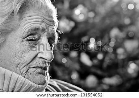 Sad old gray-haired woman - stock photo