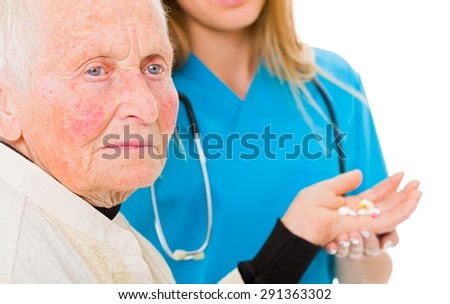 Sad old woman receiving drugs from the doctor in the background. - stock photo