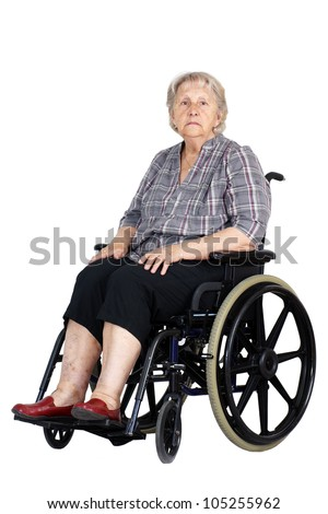 Sad or depressed senior woman in a wheelchair, looking down, studio shot isolated over white background. - stock photo