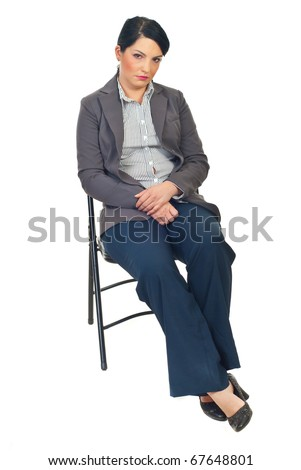 Sad or tired business woman sitting on chair and looking at camera isolated on white background - stock photo