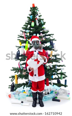 Sad santa with gas mask - environmental concept with plastic waste on christmas - stock photo