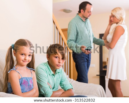 sad spanish children in silence while parents arguing at home