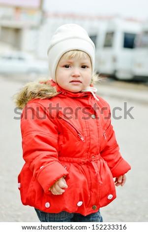 sad sweet toddler girl outdoors - stock photo