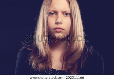 Sad teen girl, studio shot - stock photo