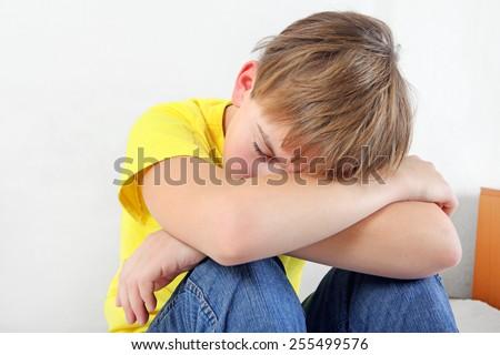 Sad Teenage Boy on the White Background - stock photo