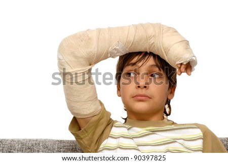 sad teenage caucasian boy with broken arm bone