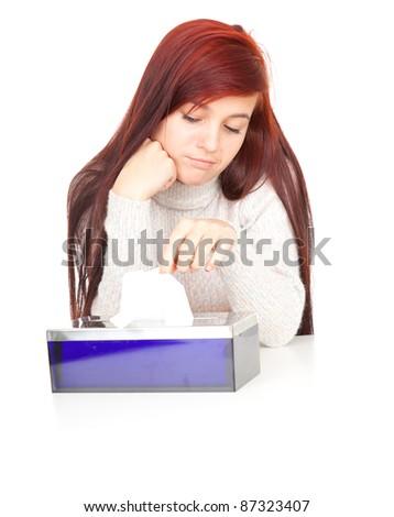 sad teenage girl with tissues, white background - stock photo