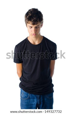 sad teenager boy grounded looking down isolated on white - stock photo