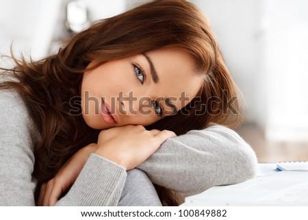 Sad teenager staring at camera - stock photo